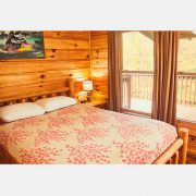 A comfortable queen sized bed in the red fox bedroom