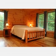 A comfortable queen sized bed in the Red Fox Log Home