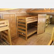 The comfortable bunk beds in the spacious Woodside Bunk House