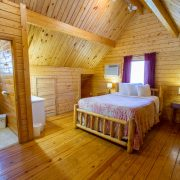 A comfy queen sized bed in an Aspen Log Home