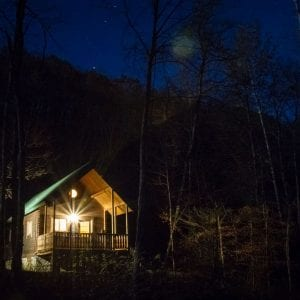 A starry night over a log cottage at ACE Adventure Resort