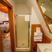 A shower inside an A-Frame chalet bathroom