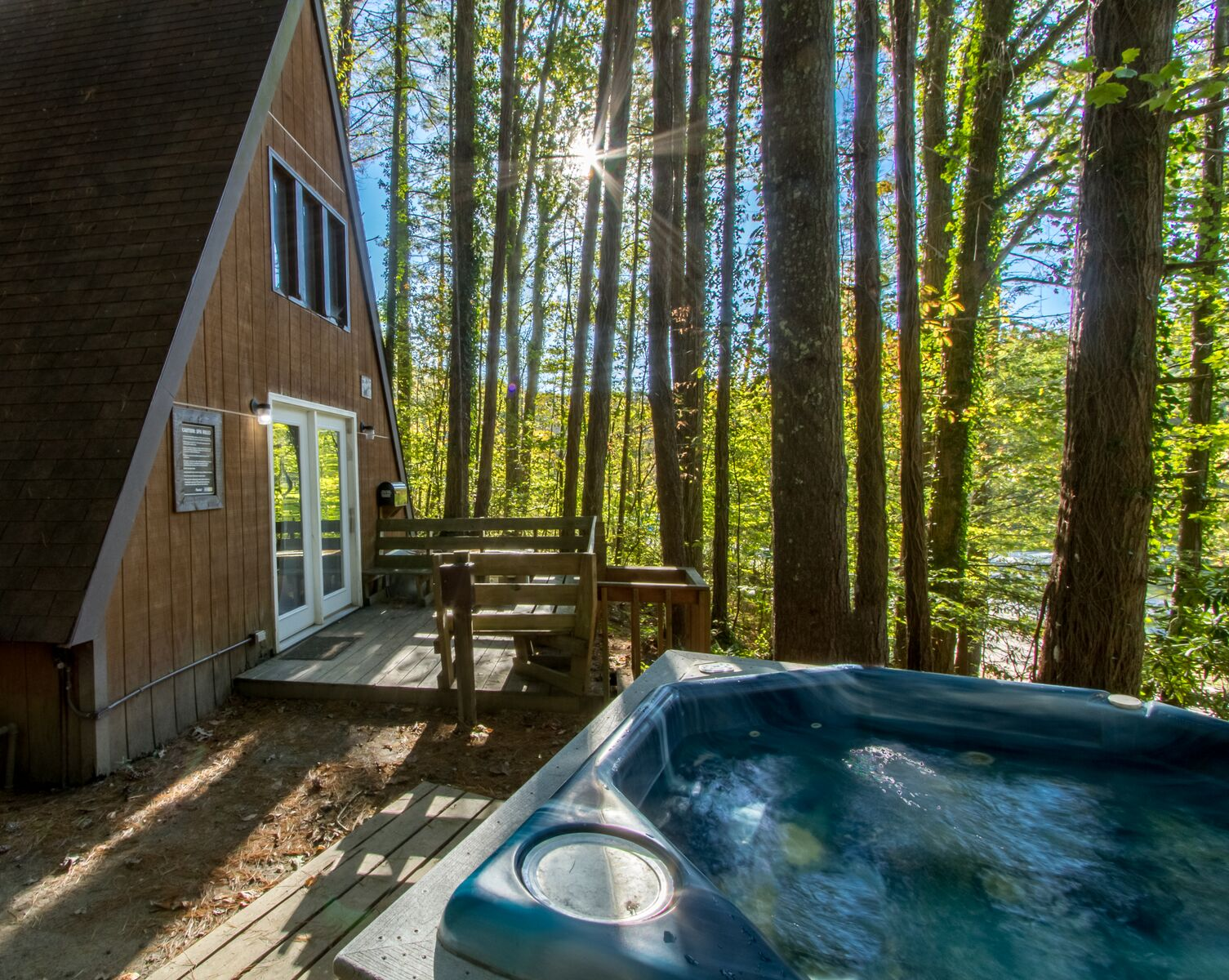 The relaxing hot tub on the porch of an A-Frame chalet
