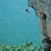 A climber rappels from rams head on the Lower New River Gorge