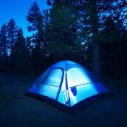 An illuminated tent at night at ACE Adventure Resort