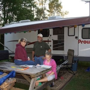 A family enjoying the outdoors by their rv