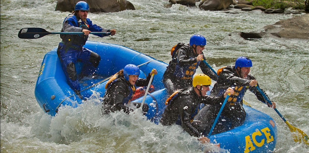 Rafters paddle down the Lower Gauley on an extreme resort whitewater rafting trip with ACE.