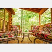 Beautiful porch furniture overlooking the woods outside the black bear cabin