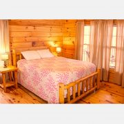 A comfortable queen sized bed in the black bear cabin