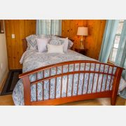 A comfortable queen sized bed in the laurel cabin bedroom
