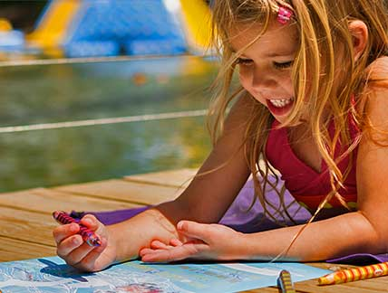 young girl coloring at waterpark