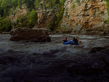 Rafting the Lower Gualey past the cliffs at Canyon Doors with ACE Adventure Resort