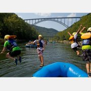 4 kids jump into the river under the New River Gorge Bridge