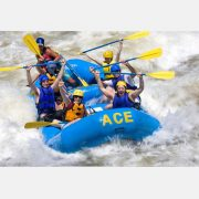 A group of paddlers celebrate as they raft the Lower New River