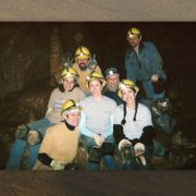 A group poses at lost world caverns