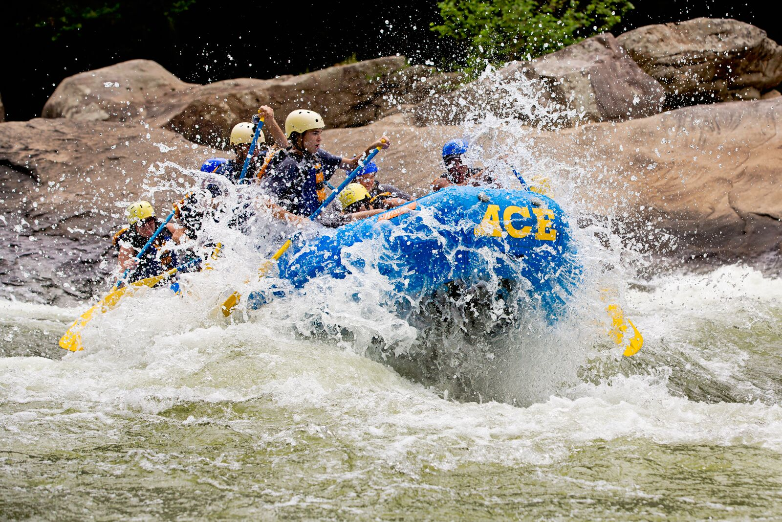 A group splashes into a rapid on a Lower New river rafting adventure