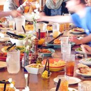 a family enjoys a feast at ACE Adventure Resort