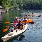 a group kayaking at summersville lake