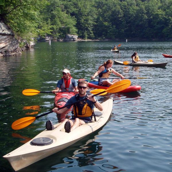 a group kayaking at summersville lake