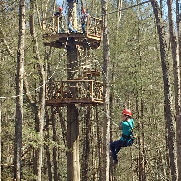 an adventurous zipliner experiences the plunge on the canopy tour