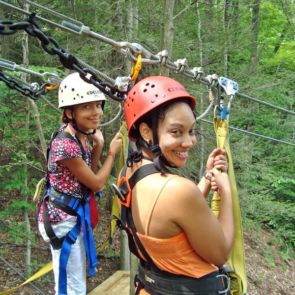 a mother and daughter prepare to launch on their first zip at ACE Adventure Resort