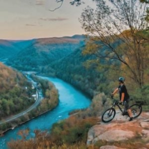 a mountainbiker checks out the view at concho overlook