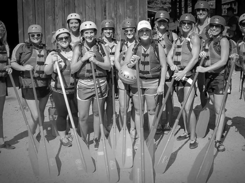A group of women prepare to head out on a whitewater rafting in the New River Gorge, West Virginia.