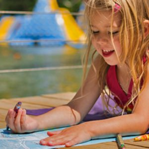 young girl coloring at wonderland waterpark
