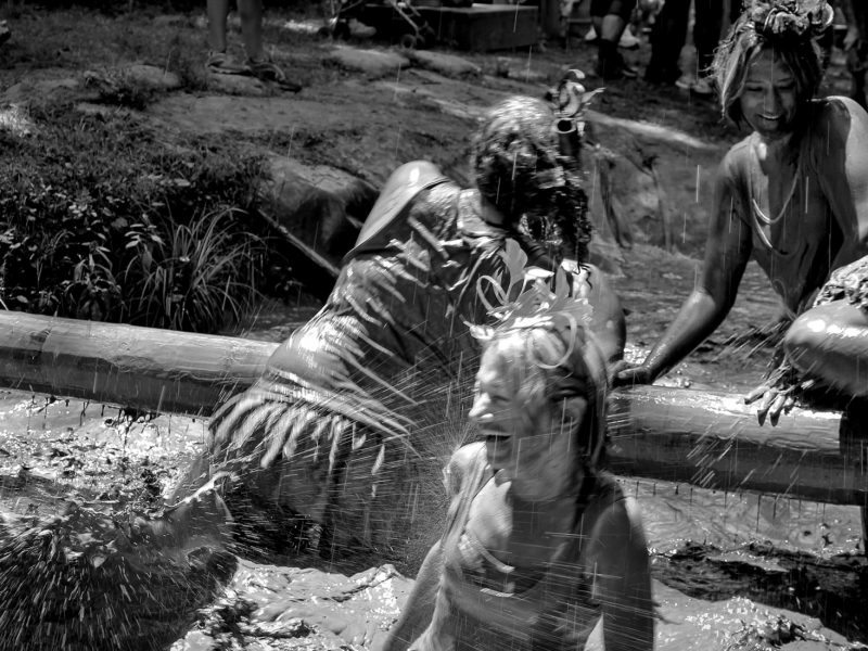 Athletes compete on a mud course during the gritty chix mud run event at ACE resort in the new river gorge