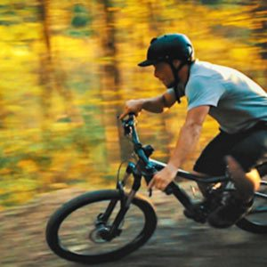 a mountainbiker races along a trail at ACE Adventure Resort