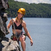 female climbing at summersville lake