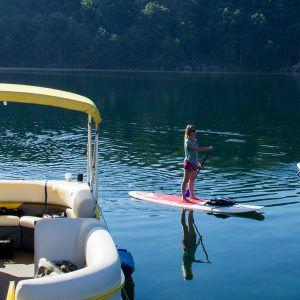 girl SUPing on summersville lake pontoon trip