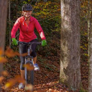 a mountainbiker rides along a trail at ACE