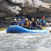 A group of guys paddling before sweets falls on the Lower to Upper Gauley River