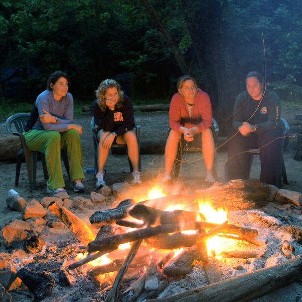 a group of friends around a campfire