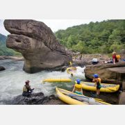 kayakers swim and paddle the shipwreck rapid of the gauley river