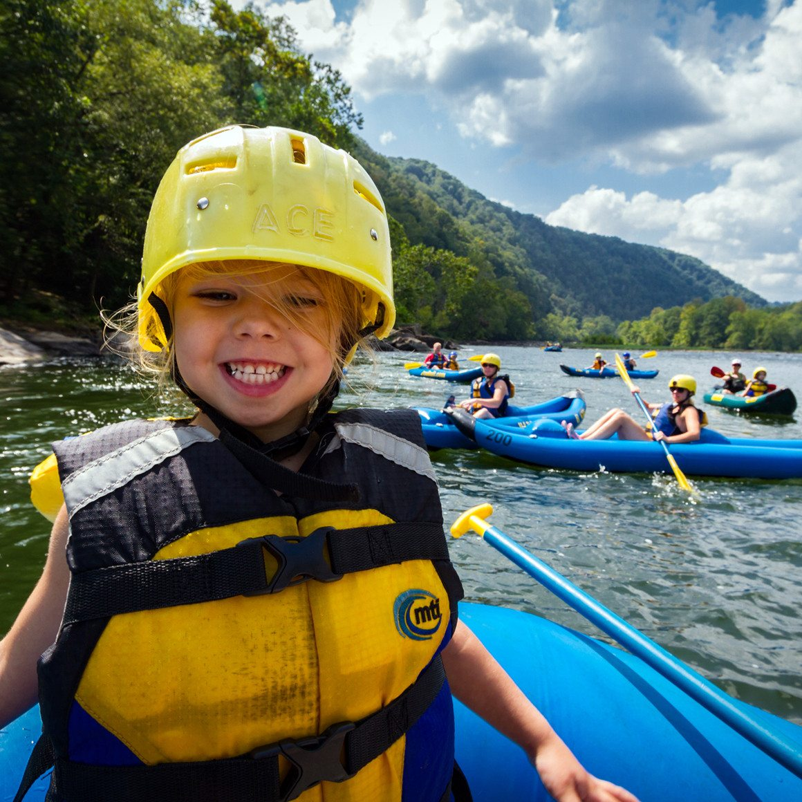 A Child Smiles on an Upper New River Family kayaking trip