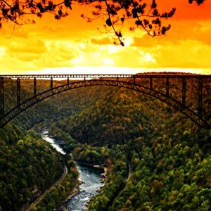 The sun setting over the new river gorge bridge