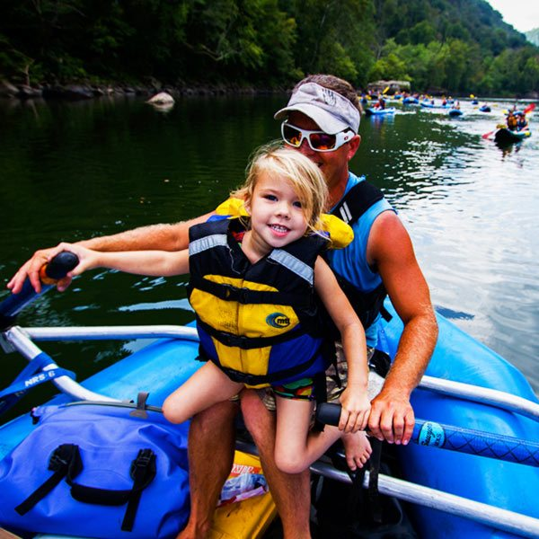 A father and his daughter enjoy a day on the upper new river