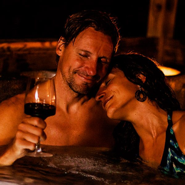 A couple enjoying one of the hot tubs at ACE Adventure Resort
