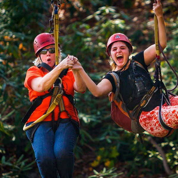 a mother and her daughter zipline together at ACE Adventure Resort