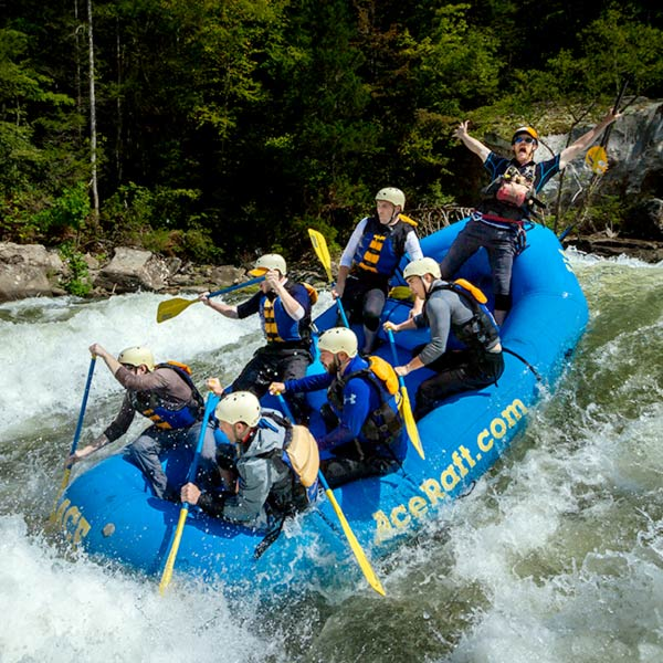a group goes over a rapid on the upper gauley