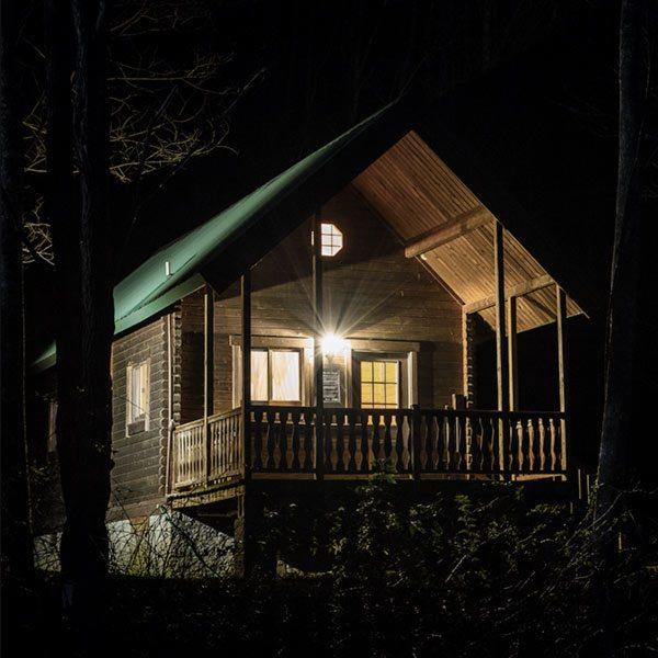 A cabin illuminated at night