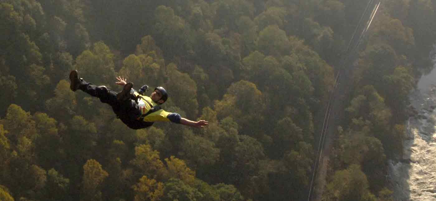 A base jumper free falls through the air off the New River Bridge before opening his parachute on Bridge Day in Fayetteville, West Virginia.
