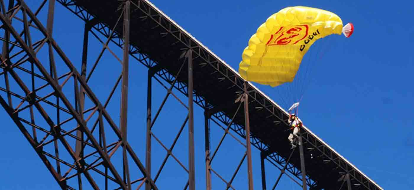 A base jumper parachutes off the New River Bridge during Bridge Day at the New River Gorge in Fayetteville, West Virginia.