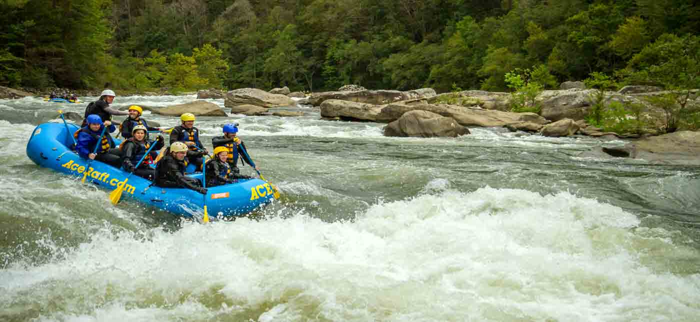 A group navigates the lower Gauley River on a whitewater rafting trip in the New River Gorge, West Virginia.