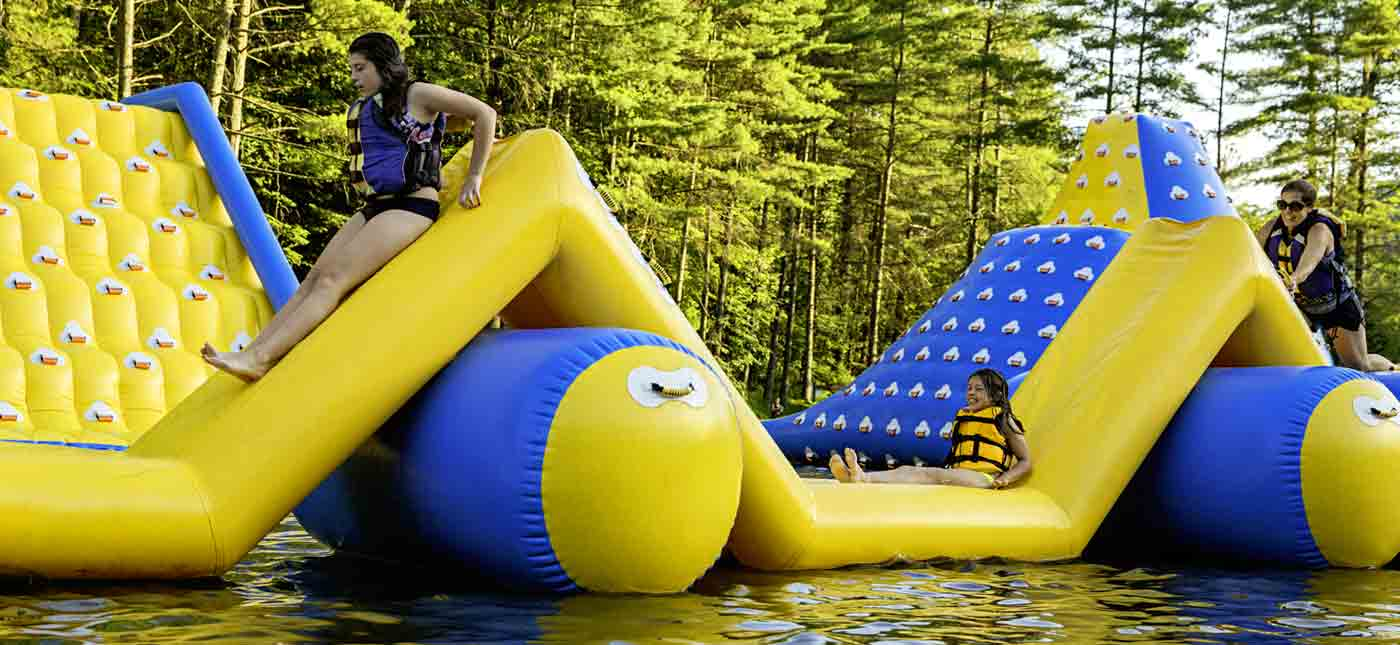 Children climb and play on an inflatable caterpillar floating on the lake at Wonderland Waterpark.