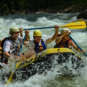 Rafters paddle through a rapid