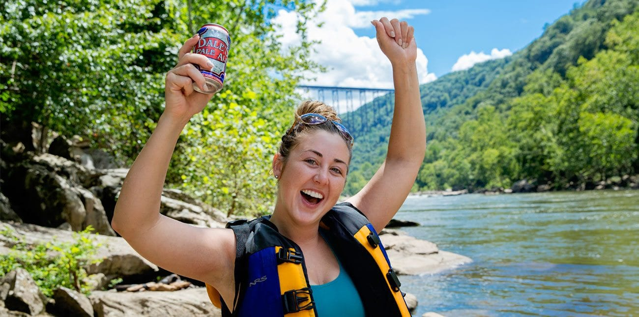 girl excited about getting a beer after rafting