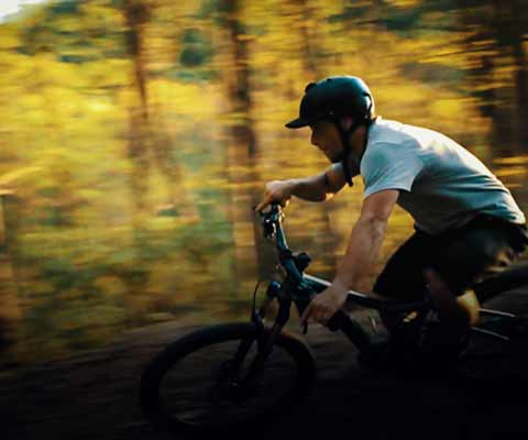 A mountain biker banks a turn on a trail at ACE Adventure Resort.